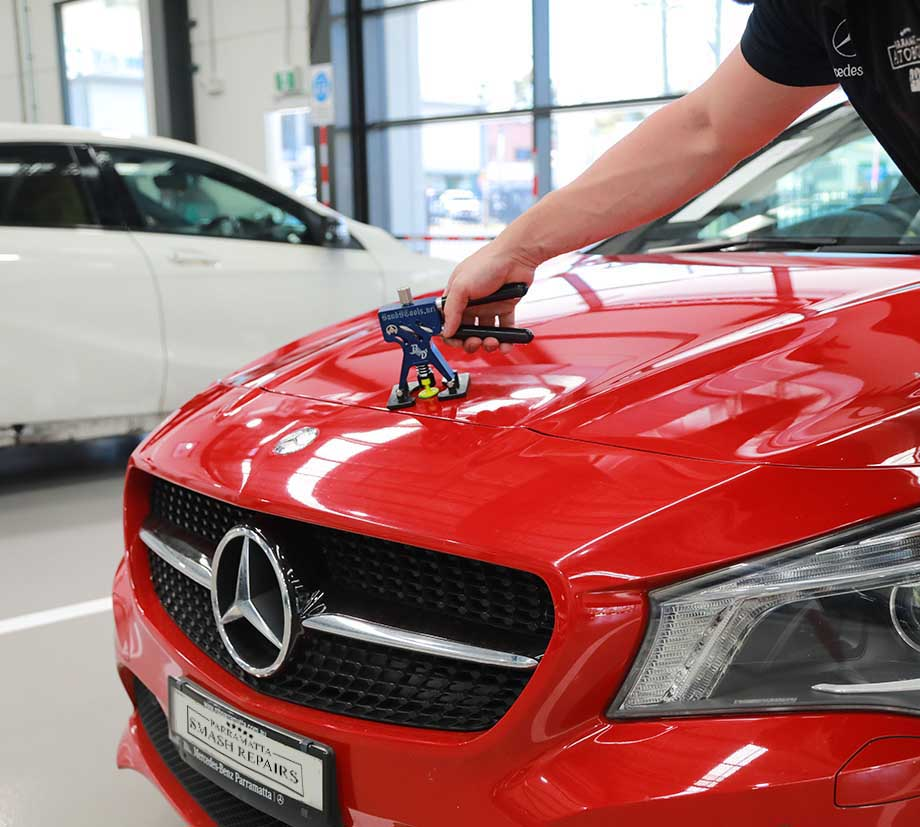 parramatta smash repair paintless dent removal on red mercedes